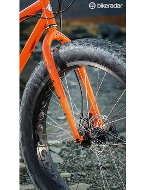 The wide rigid fork gets a full complement of mounts
