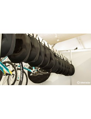 Astana's Specialized helmets are stored between uses