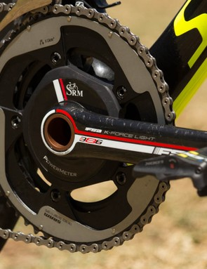An SRM FSA crank with SRAM chainrings, turning a FSA chain inside a Shimano Di2 front derailleur. This mix-and-match combination is very unexpected at World Tour level