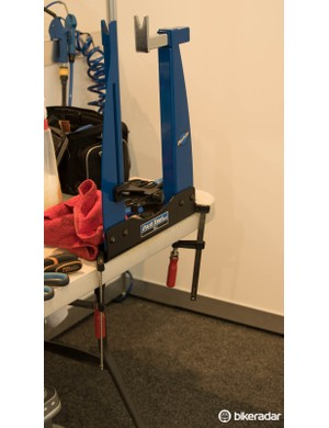Most teams bring some form of basic truing stand with them - such as this Park Tool Home Mechanic model
