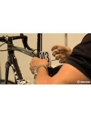 Most teams have their own ways of mounting race numbers to bikes. A bolt-on mount is probably the most common