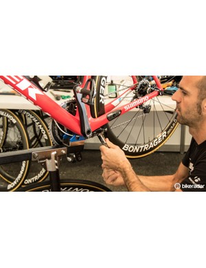 Adjusting the brake on a Trek Madone. Most Trek Factory Racing riders were actually on the Domane