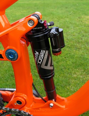The svelte twin-tube piggyback shouldn't get in the way of bottle cages on most frames
