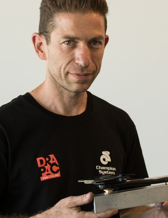 Australian Jesse Geisler got his start in the earliest days of professional mountain bike racing as a specialist technician. Since then, he's set up a successful fabrication business and built a strong reputation for himself as a mechanic. He's holding a tool he created for his own use, to hold the crank while power meter spider bolts are accurately torqued
