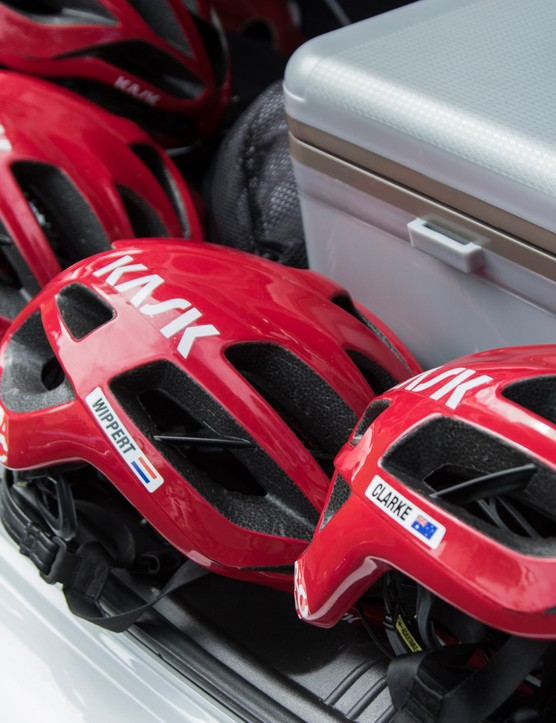 Helmets await riders, while the boot holds spares and hydration for the race