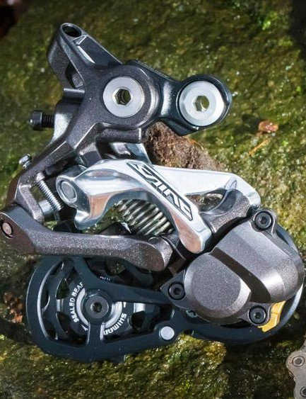The rear derailleur is reinforced where it counts to help fend off damage
