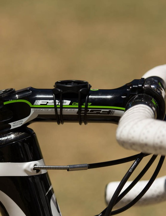 Hesjedal rides a relatively tiny a 56cm frame size, with a long 140mm FSA stem making up the reach