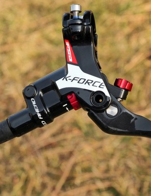 The FSA K-Force hydraulic disc brakes feature adjustable pad contact and lever reach, carbon fibre blades, magnesium master cylinders and calipers, and titanium hardware
