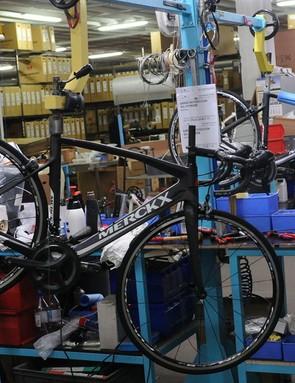 The Merckx factory floor with its bespoke bike building stands