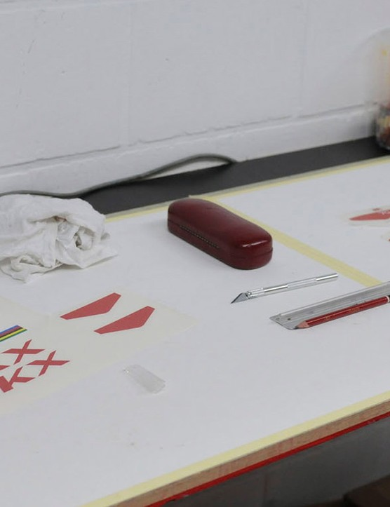Frame decals being prepared for application