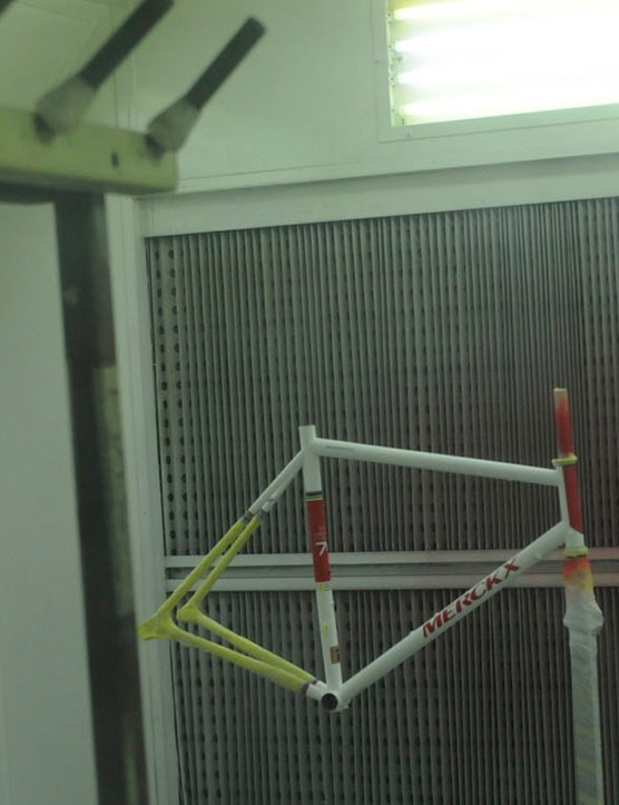 A frame in the spray booth for its clear lacquer coat