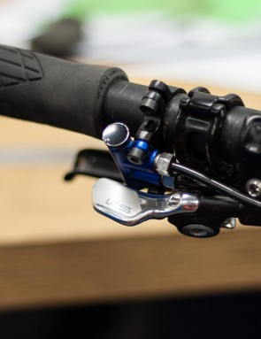 The geometry adjustment system has a lever that is minimal enough to work alongside a remote dropper lever
