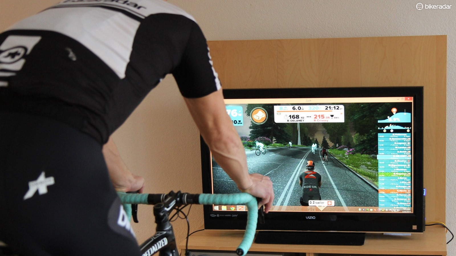 Zwift is an online software. Here, we connected a computer to a TV for a better viewing experience. (Typically we just take the laptop in the garage)