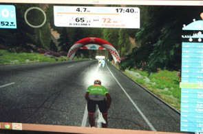 When you accelerate, your rider jumps out of the saddle in a fairly realistic simulation. The KOM finish line is the red banner
