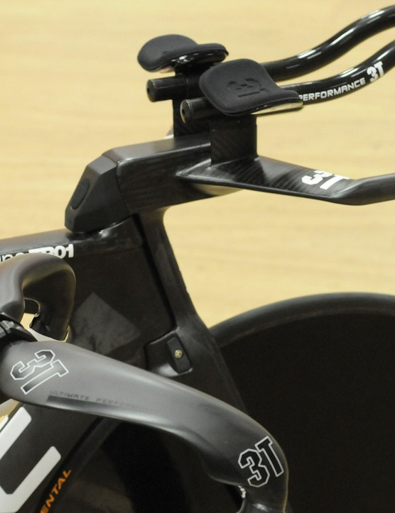 Rohan Dennis' hour record attempt bike alongside a stock TR01 showing the difference between the standard adjustable stem and Rohan's custom built one-piece integrated model
