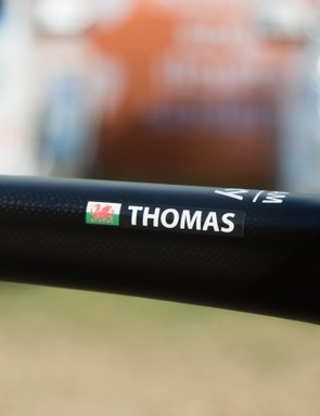 The unmistakable red dragon of the Welsh flag sits proudly next to Thomas' name