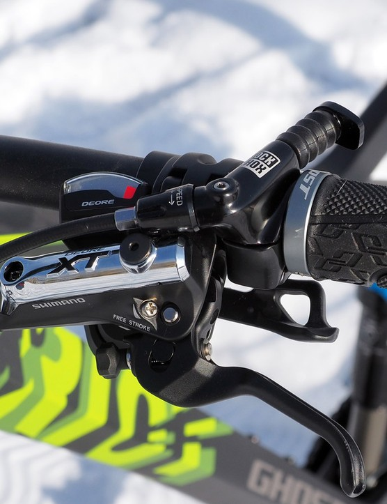 The two-ring drivetrain, Shimano Deore XT brake lever, and RockShox Reverb dropper seatpost remote add up to a rather crowded cockpit