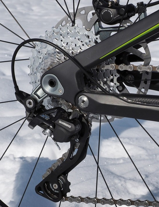The rear derailleur bolts to a direct mount hanger