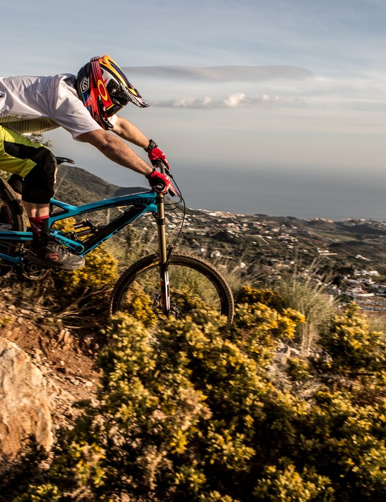 Olly Forster ignoring the stunning views and having too much fun on the BOS equipped YT Tues CF Pro on the B-Track in Malaga