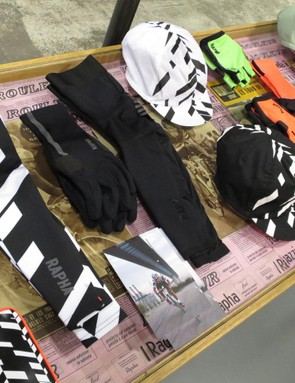 A selection of Data Print kit including socks, essentials case, arm warmers and caps