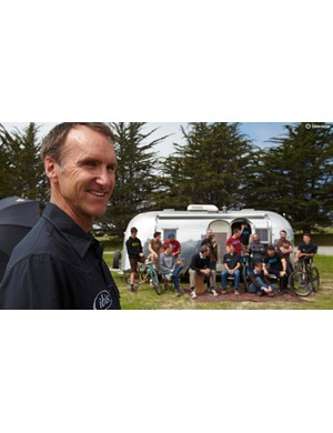 Scot Nicol and the Ibis crew, sitting outside an Airstream trailer at the Ibis factory