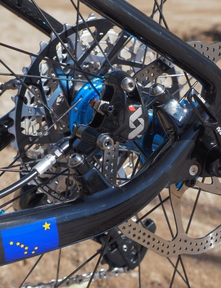 The rear brake caliper is safely tucked away in between the stays