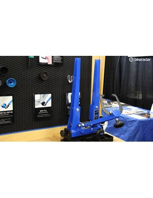Park Tool now has a consumer-level version of its venerable truing stand. The TS-2.2p is nearly identical to the shop-quality version, it does away with the chrome plating in favor of a powdercoat to cut costs