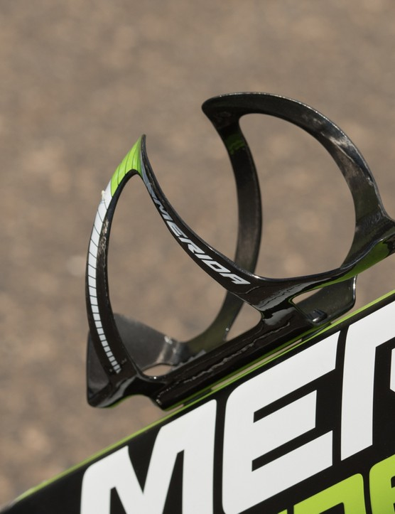 Not at all a common thing, Merida includes a carbon bottle cage with the Reacto. Although you'll likely want to buy a second one to match, so clever
