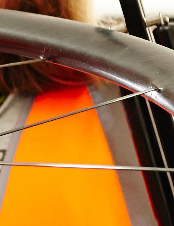The carbon spokes appear to be bonded directly to the rim, meaning the wheel will likely have to be sent away for repairs
