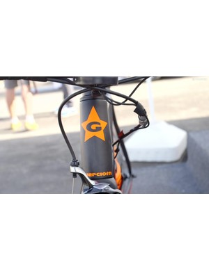 Guerciotti's logo is displayed in orange livery on the head tube