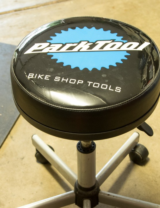A shop stool is a great addition for relaxing or having guests — bike branded model optional