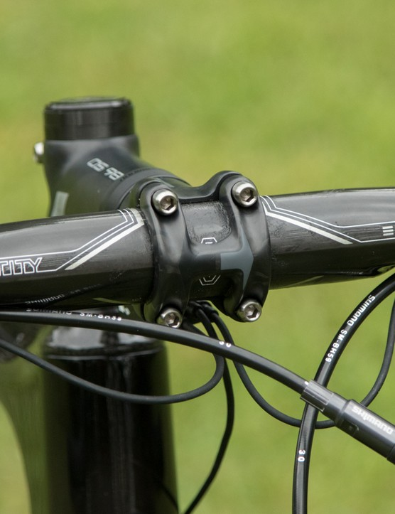 The house-brand carbon bar offers an ergonomic shape and classy internal cabling. We'd prefer one with a shorter reach for this style of bike though