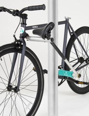 The bike can be secured to immovable objects 8in or less in depth
