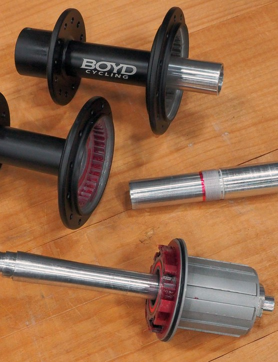 The stub axle is threaded into the main hub shell and kept in alignment with the long guide section on the left. The two-piece construction also allows for a more durable 6061 hub shell and a harder 7075 axle
