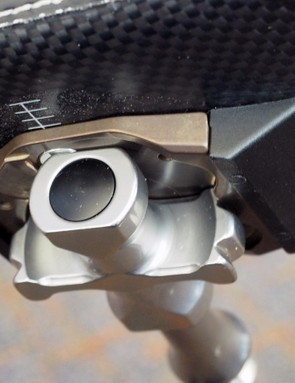 There are no moving parts in the retention mechanism. Instead, the pedal body and cleat connect with a rotating dovetail-like interface
