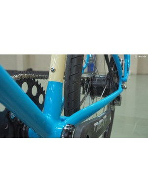 The seat tube flares in diameter and gains a squared-off profile as it meets the bottom bracket