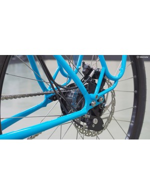 The derailleur and rear brake lines run in a tightly packed bunch nearly all the way back