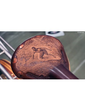 Yep, that's actually a leather carving of the bike's owner