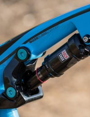 The rear shock sits high in the frame with little wasted space