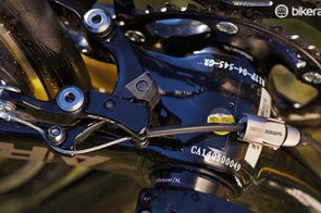The rear brake sits under the chainstays behind the bottom bracket to make it more aero