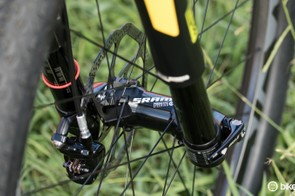 a SRAM Rise 60 wheel with 'predictive steering' front hub sits within the RockShox RS-1 fork