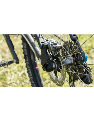 Shimano XTR brakes drop weight by not using the finned 'IceTech' brake pads. Note the new Shimano M9000 rear hub laced to a very light Stan's Race Gold 29er rim
