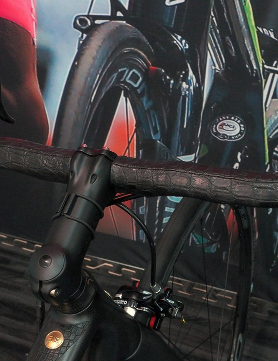 The Enve carbon bars are wrapped with stitched crocodile hide