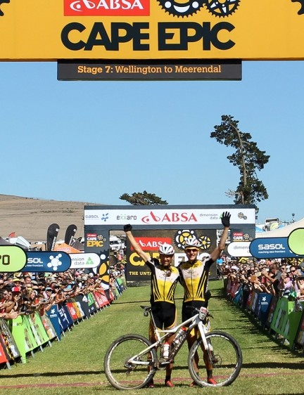 Standing at the finish of stage 7, Kulhavy and Sauser celebrate winning the 2015 Absa Cape Epic