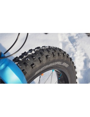 The stock Schwalbe Jumbo Jim tires roll quickly and grip quite well on dry ground but you really have to lower pressure dramatically to get traction on loose snow or mud