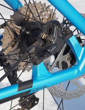 The rear brake caliper bolts directly to post-mount tabs