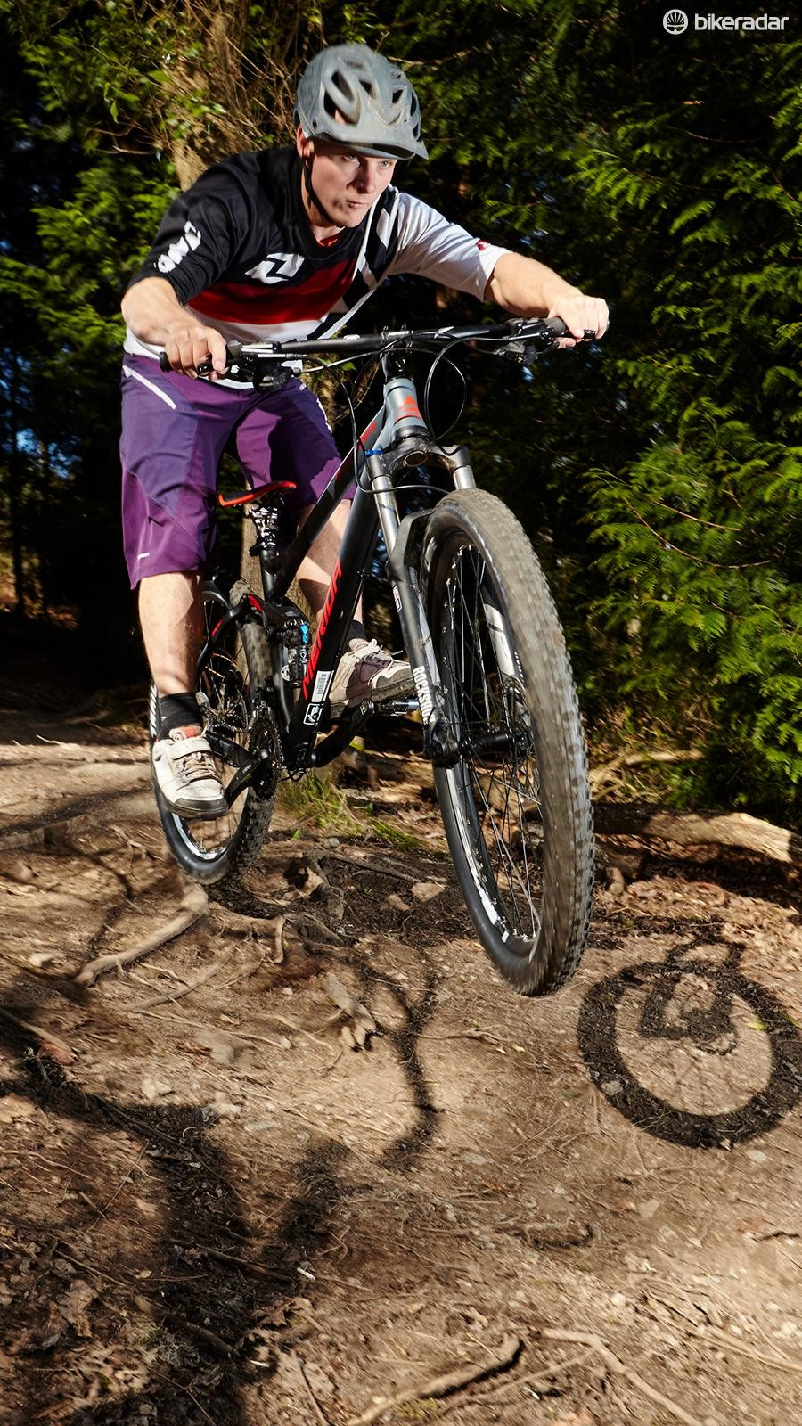 The Merida is impressively stable and competent on fast, rough descents, though the basic fork limits its downhill performance