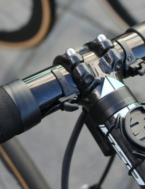 Stijn Vandenbergh has a more easily visible sprint shifter set-up. Shimano designed the two-button climbing shifter for the thumb position, but many riders find it too cumbersome. This solution requires some ingenuity and wire splicing on the part of Etixx mechanics