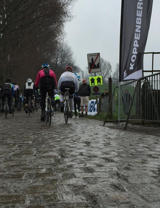 One of the (in)famous climbs of De Ronde, the 600m Koppenberg averages nearly 12 percent, kicking to 22 percent in the middle. And wet cobbles are slick as greased metal