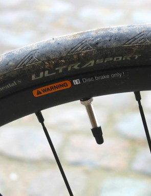 I ran the stock Continental Ultra Sport 28mm clinchers at about 78psi front and rear (I weigh 195lbs/88.5kg)